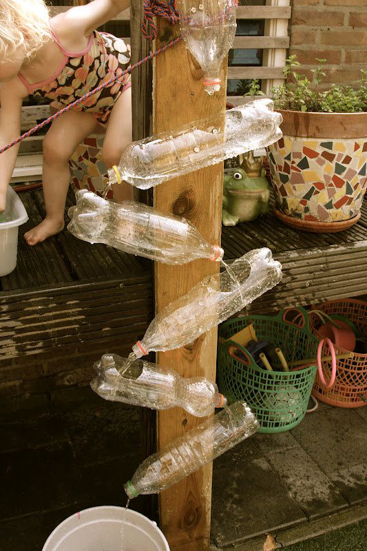 http://greengardenblog.com/2013/01/16/recyled-plastic-bottles-become-a-waterwall-could-easily-decorate-these-with-any-theme-use-spray-paint-etc/